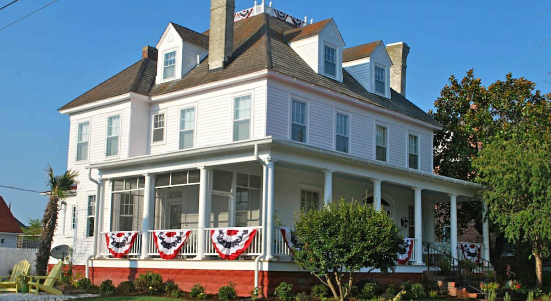 The stately Inn basks in the sun, red, white and blue bunting draped over the railings of the wraparound porch.