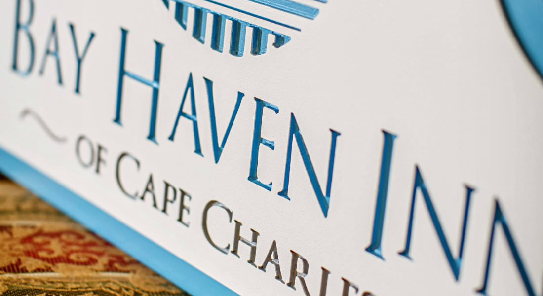 A white sign with the text: Bay Haven Inn of Cape Charles.
