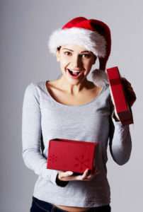 Girl opening a holiday gift