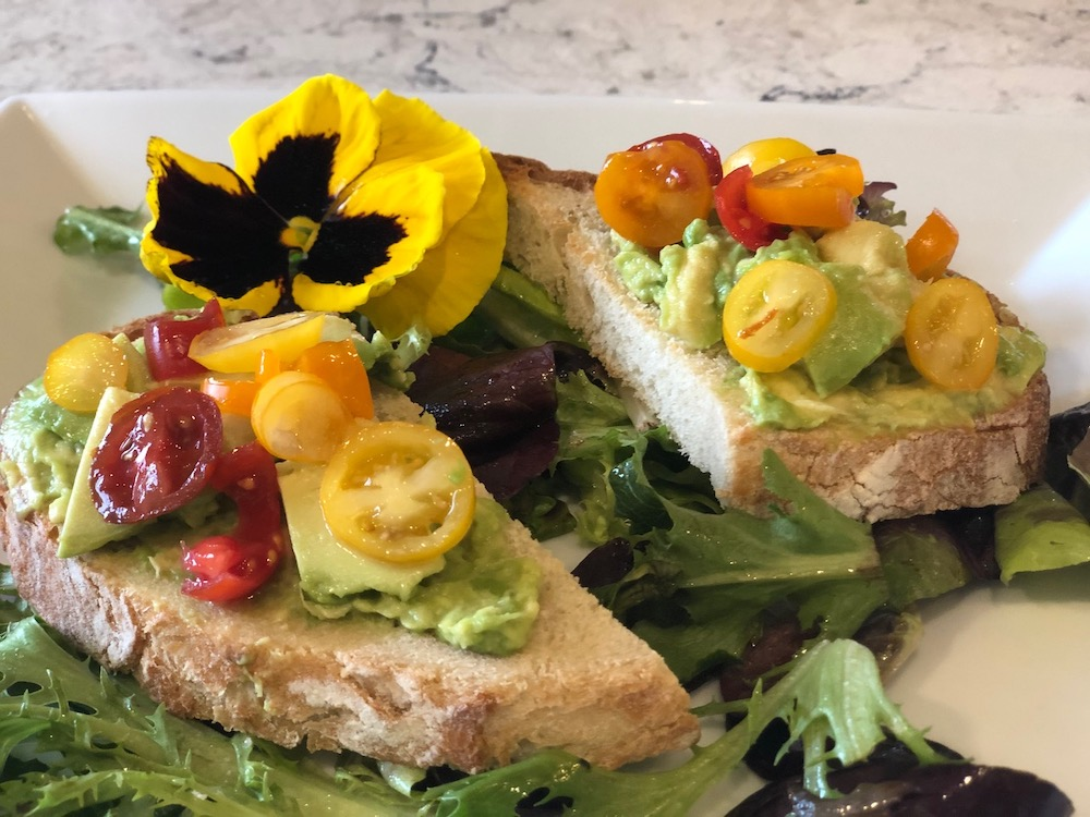 Sandwich with veggies and a pansy