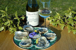 Wine bottle with a plate of oysters
