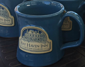 Two blue coffee mugs with a beige logo and the text: Bay Haven Inn, Cape Charles.