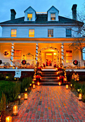 The votive-candle lined red brick walkway and stairs of the Inn lead up to the front porch.